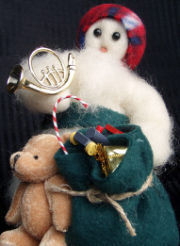 """Packing Up"" Wooly® Primitive Snowman as Santa Claus"